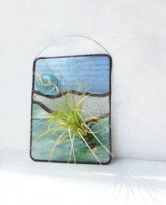 Pretty stained glass air plant holder.