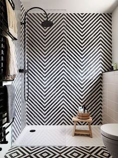 Wow these geometric scandi tiles are crazy on my eyes, not sure I'd use them in my own home but they look great. Love the Matt black shower though and the simple scandi tones #DesignBathroomssimple