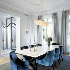 grey dining room with blue chairs