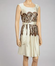 Lustrous fabric bedecks this fancy frock, while a sash tie flatters for an evening look to remember.