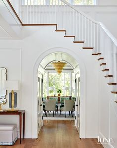 The entry features an arched... Stairs, Old Houses, Luxe Interiors, California Homes, Entryway Table Decor, Big Windows, Modern, Interior Design, Home Decor