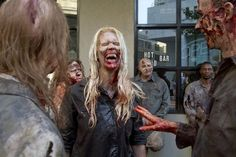 Zombie extras crack up on the scene of The Walking Dead. Description from indulgy.com. I searched for this on bing.com/images