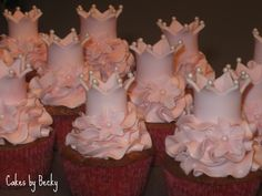Princess Cupcakes - These cupcakes were for a Princess themed baby shower - pink vanilla swiss meringue buttercream with gum paste crowns and gum paste flowers brushed with a touch of pink shimmer dust :) So fun and girly!
