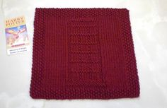 Charted pattern for a Ministry of Magic Visitor's Entrance square inspired by Harry Potter. Suitable for a variety of uses - blanket square, dishcloth, facecloth, etc.