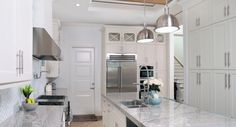 Large galley kitchen. Stainless steel appliances, granite countertop and island. Home custom designed by Don Stevenson Design located in Naples, Florida. www.donstevensondesign.com