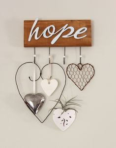 What an adorable collection of Hope Hearts - that's what I've called them. Inspirational and would look lovely in your home - and they look easy enough to make. You could simply use wire hearts, pretty fabric hearts and felt embroidered ones, too. ;) Mo