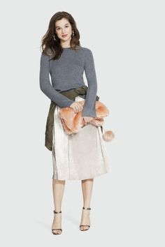 Earlier this year, Who What Wear teamed up with Target to launch a collection full of street-style-inspired staples. Dress down a micro-pleat skirt, high-heels, and a furry clutch with a thin bell sleeve sweater.