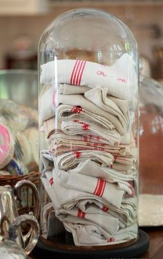 Great way to display vintage tea towels! (OR vintage lace hankies~ Vintage Dishes, Vintage Tea, Vintage Linen, Vintage Kitchen, Cloche Decor, Towel Display, Display Case, The Bell Jar, Bell Jars