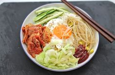 Looking for a quick, healthy  and super tasty meal? Try bibimbap! A korean mixed rice dish with spicy korean pepper paste and a runny fried egg in the middle.