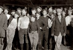 """November 15, 1909. Bridgeton, New Jersey. """"A few of the workers on night shift at Cumberland Glass Works. One boy is 13 years old."""" A livelier than usual crowd as far as facial expressions go. Photograph by Lewis Wickes Hine."""