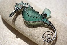 AQUA TEAL seahorse wire wrapped seaglass pendant   http://www.etsy.com/listing/75734390/20-off-aqua-teal-seahorse-wire-wrapped#