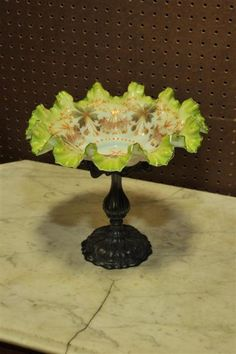 VICTORIAN GLASS BRIDE'S BOWL AND STAND. Cased white to green bowl with enameled floral and foliate decoration in Autumnal colors. Rests on a silver plated stand by ''The Knickerbocker Co''.