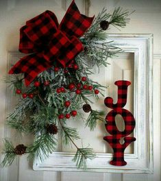 White distressed picture frame. Greenery with plaid bow. Joy covered in matching fabric