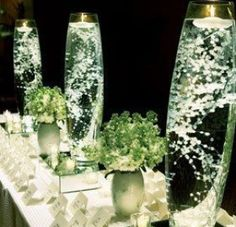 So easy .. it takes a vase fill with water and baby's breath and puts a floating candle on top.  Nicely for the windowsill or at a dinner party in the middle of the table, tjidens a wedding etc.