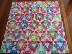 Hopscotch quilt top using 'Tradewinds' jellyroll. 60 degree design