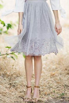 No closet is complete without a tulle midi skirt! This pretty grey piece has an elastic waist for a better...