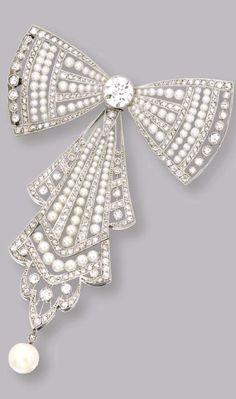 PLATINUM, SEED PEARL AND DIAMOND BOW BROOCH, CIRCA 1910 Of openwork design set in the center with an old European-cut diamond weighing approximately 1.60 carats, accented by smaller old European-cut and rose-cut diamonds weighing approximately 2.15 carats, further set with seed pearls measuring approximately 3.1 to 1.4 mm., suspending a natural pearl drop measuring approximately 7.3 mm., one diamond missing.