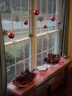 Christmas ball window decor. Walmart has packs of sparkly ornaments for a dollar- perfect for this.