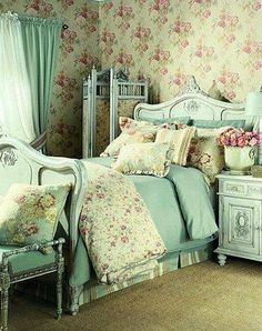 Shabby bedroom with real green furniture and floral linens. So wonderful!