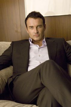 Holy crap, how could I forget about Julian McMahon???  To the actresses who got to simulate sex with him on Nip/Tuck, I salute you!