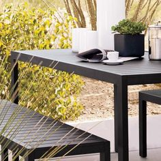 Piana Rectangular Outdoor Dining Table. The Piana dining table speaks to laid back, casual dining. Made from powder-coated aluminium, the design features modern clean lines with an aluminium slatted table top. Practical, playful and stylish.