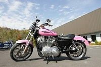 """Beautiful """"pink"""" Harley Davidson.  Every man loves a girl on a bike!  Make the bike a Harley and men are """"head over heels"""".  Add """"heels"""" and men are no longer literate ;)"""