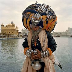 Sikh warrior,India. In the background the Golden Temple in Amritsar.