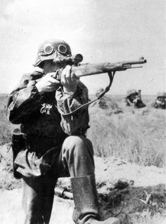 German sniper takes aim without cover. His target is probably an artillery emplacement which offered multiple targets in the form of a crew moving about constantly in order to service the gun -- and doing so without effective defense against such long range shots.