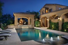 Mediterranean Swimming Pool with exterior tile floors, outdoor pizza oven, Raised beds