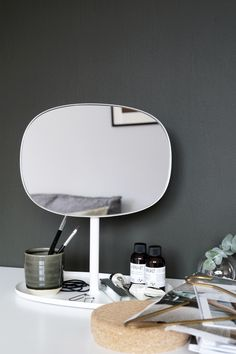 Dark green walls - white flip mirror by Normann Copanhagen perfect for my makeup table - Hege in France