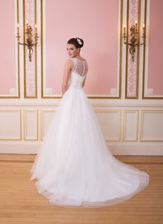 This illusion Sabrina neckline is trimmed in satin and the bodice is  adorned with lace appliques. A pleated cummerbund cinches the waist of  this tulle and lace ball gown. Tulle buttons cover the back zipper and  ends in a chapel length train. https://www.sweetheartgowns.com/sweetheart/6007