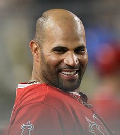 Game #62 6/11/12: Albert Pujols #5 of the Los Angeles Angels of Anaheim laughs in the dugout in the game against the Los Angeles Dodgers on June 11, 2012 at Dodger Stadium in Los Angeles, California. (Photo by Stephen Dunn/Getty Images)