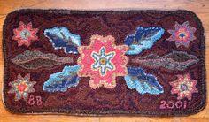 hooked rug - primitive flower by {studiobeerhorst}-bbmarie, via Flickr