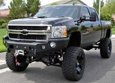 Big black jacked up truck♥ Rollin on 35s...  (this is how you get a pretty girl by your side - unless you are a girl perhaps)