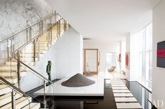 An Asian-Inflected Penthouse design in New York could easily could be at home in California Design Style.