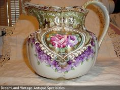 Cider Pitcher, Art Nouveau ,hard paste, molded tankard shape, roses and violets, gold gilt, beads, handpainted, Sitzendorf, Thuringia, Germany c.1900-1920 This is a lovely pitcher