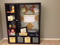 Flipped it on its side and transformed an Ikea media cabinet into an office organizational center!