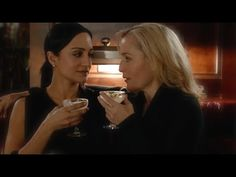 Gillian Anderson kisses Archie Panjabi - YouTube