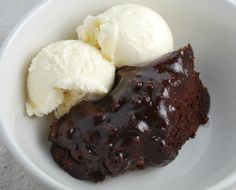Slow Cooker Hot Fudge Cake  ~~~  Slow Cooker Hot Fudge Cake is a great recipe to make when you are craving chocolate. It's made with ingredients you likely have in your cupboard already – no need for a trip to the store! This cake is moist and gooey – the perfect combo of cake and fudge. Serve with ice cream and/or whipped cream. Enjoy!
