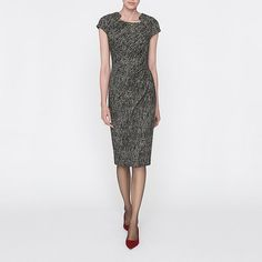 Master workwear dressing with Malory. This beautifully tailored dress combines a monochrome palette with a flattering fit to elegant effect. A high neckline and draping at the hip, draws the eye in and makes for the sleekest silhouette. Classic courts are ideal for 9 to 5 style, and then opt for a clutch and sandals to take Malory from desk to dinner.