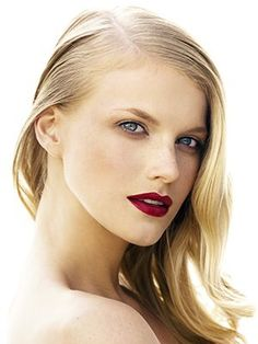 sleek side-part hairstyle with deep red lips and glowing skin