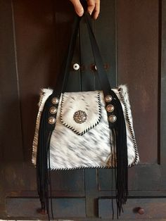 A salt and pepper hide Bonnie Bag, stitched in black leather lace with a Swarovski Crystal Concho on the flap. Lined with two interior pockets. gowestdesigns.us