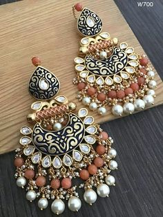 Pinterest • @KrutiChevli • For order WhatsApp: +919512533022. Shipping Worldwide #indianjewellery #indianbride #punjabibride #sikhbride #indianwedding #southasianbride #diamondearrings #chandbali #blousedesigns #weddingjewellery #bridaljewelry #punjabijewellery #pakistanijewellery #southindianjewellery #weddinglehenga #maangtika