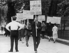 Gay rights pioneer Frank Kameny, the second man in line holding a sign, insisted his protesters wear suits. This was taken outside the White House in 1965. (UPI)