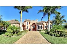 """20241 Riverbrooke Run, Estero, FL 33928 — This home site is located on Riverbrooke Run which is comprised of only homes that are 4,000 square foot or greater. This Hine Group """"Praglia"""" floor plan is Luxury living at its finest. It is a split floor plan with over 4,400 square foot of living space, 4 bed plus a den, 4 and a half baths, and an oversized 3 car side entry garage. This home truly is decorated like a model and sold Furnished. It is brand new and never been lived in.  It has a…"""