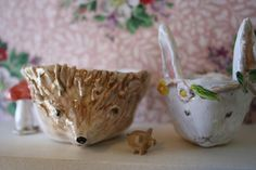 Julie Whitmore Pottery--I would love to have these cups sitting on my shelf.