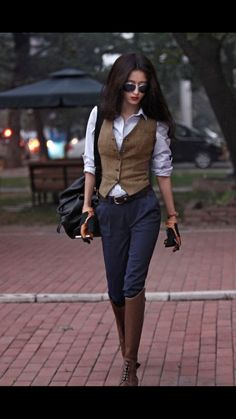 navy pants white shirt brown vest