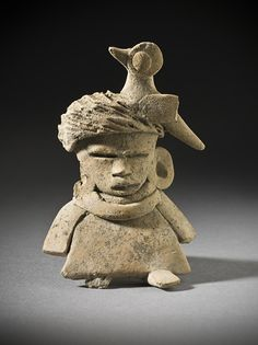 Seated Female Figure  Mexico, Basin of Mexico, Teotihuacan, Teotihuacan, 150-450  Sculpture  Slip-painted ceramic  Height: 3 1/2 in. (8.89 cm)  LACMA