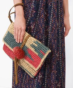 Little painted raffia bag - Sport - Autumn Winter 2016 trends in women fashion at Oysho online. Lingerie, pyjamas, sportswear, shoes, accessories, body shapers, beachwear and swimsuits & bikinis.