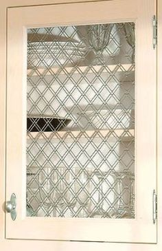 Decorative Wire Grilles Give Kitchen Cabinets A Vintage Look